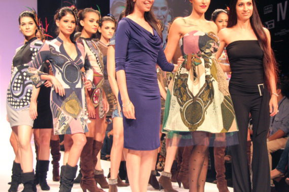 MUMBAI, INDIA - AUGUST 20: Bollywood actress Neha Dhupia walks the ramp displaying the collection of designer Pam and Arch London during Lakme Fashion Week-Winter/Festive 2011 in Mumbai on Saturday August 20, 2011. (Photo by Yogen Shah/India Today Group/Getty Images)